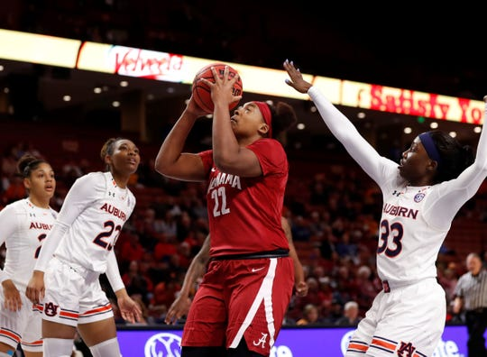 Alabama's Ariyah Copeland (22) scores two of her 11 points in the Tigers' 53-52 win over the Tide Thursday in the SEC Women's Basketball Tournament in Greenville, S.C.
