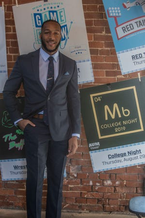 Auburn Montgomery senior Preston Collins designed the College Night t-shirt, that will be presented free to Montgomery Biscuits fans on Aug. 29.