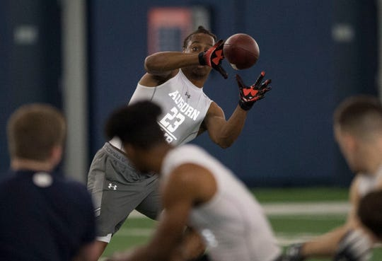 Auburn wide receiver Ryan Davis (23) catches the ball as he runs a drill during pro day at Auburn Athletic Complex in Auburn, Ala., on Friday, March 8, 2019.
