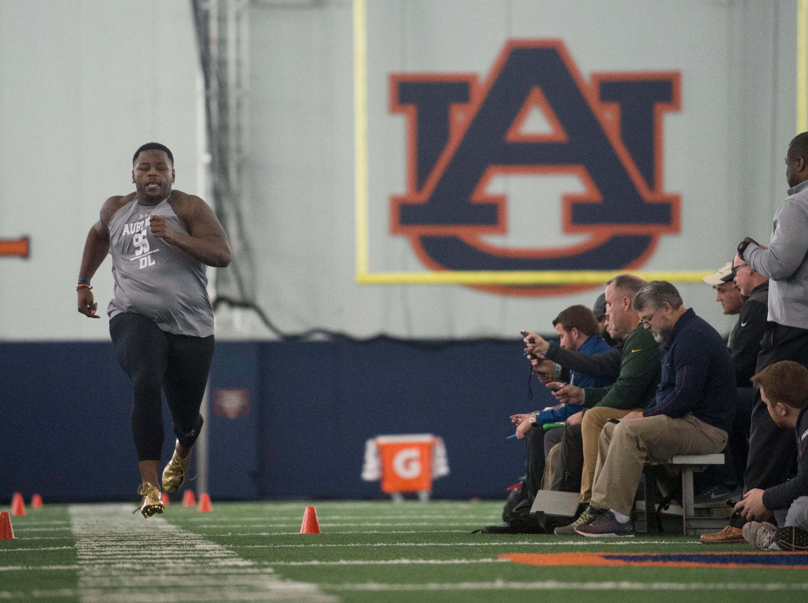 Auburn defensive lineman Dontavius Russell (95) runs the 40-yard-dash during pro day at Auburn Athletic Complex in Auburn, Ala., on Friday, March 8, 2019.