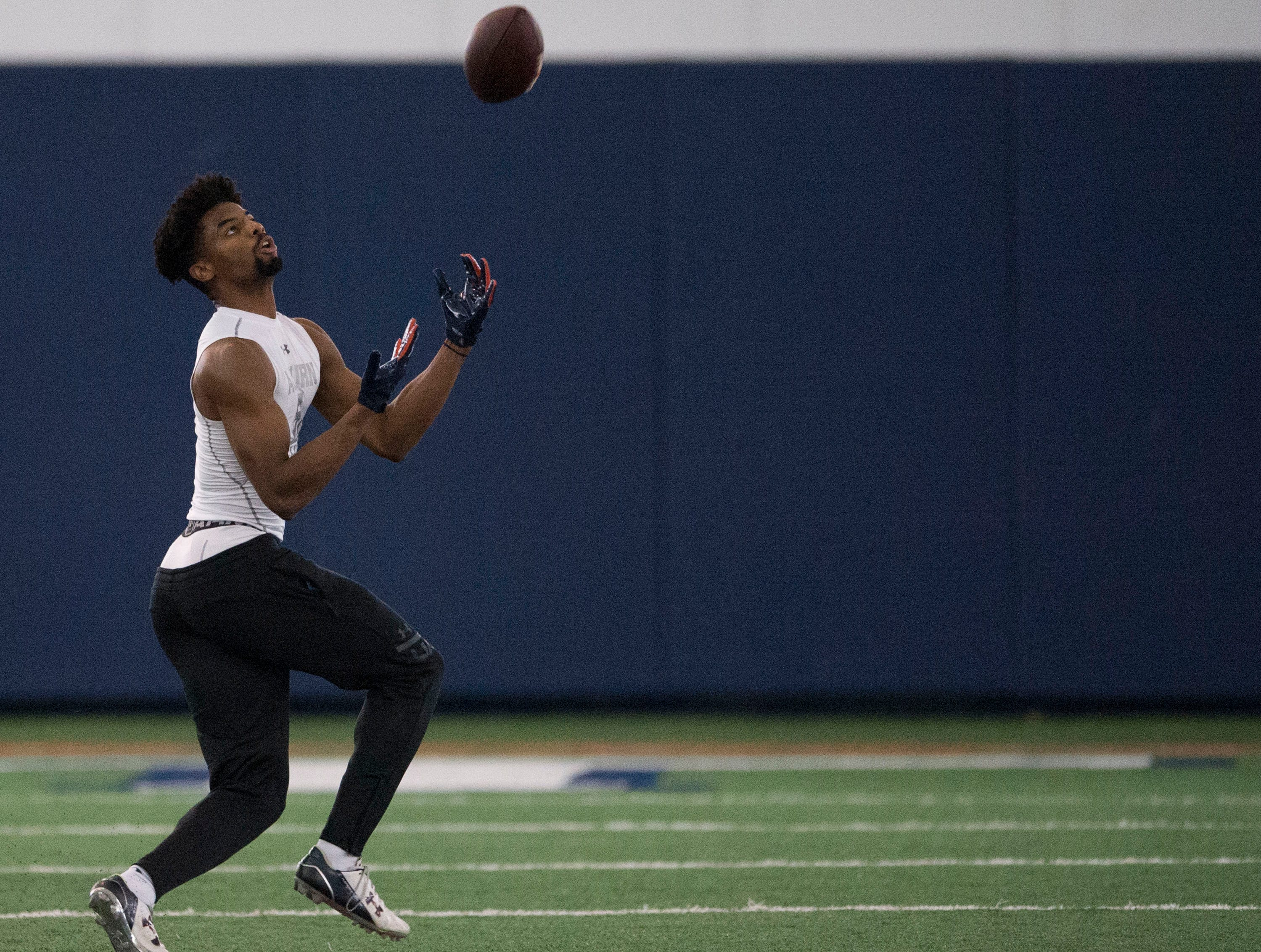 Auburn wide receiver Darius Slayton (81) catches the ball as he runs a drill during pro day at Auburn Athletic Complex in Auburn, Ala., on Friday, March 8, 2019.