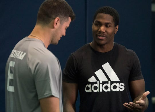 Auburn quarterback Jarrett Stidham (8) talks with former Auburn running back Kerryon Johnson during pro day at Auburn Athletic Complex in Auburn, Ala., on Friday, March 8, 2019.