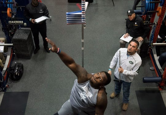 Auburn defensive lineman Dontavius Russell (95) tests his vertical jump during pro day at Auburn Athletic Complex in Auburn, Ala., on Friday, March 8, 2019.