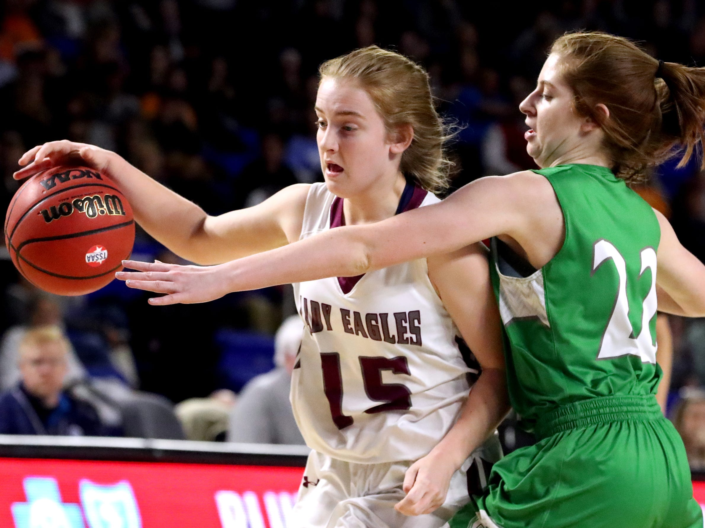 Eagleville's Makayla Moates (15) moves the ball around the court as Midway's Emily Cawood (22) guards her during the quarterfinal round of the TSSAA Div. 1 Class A Girls State Tournament, on Thursday, March 7, 2019, at Murphy Center in Murfreesboro, Tenn.