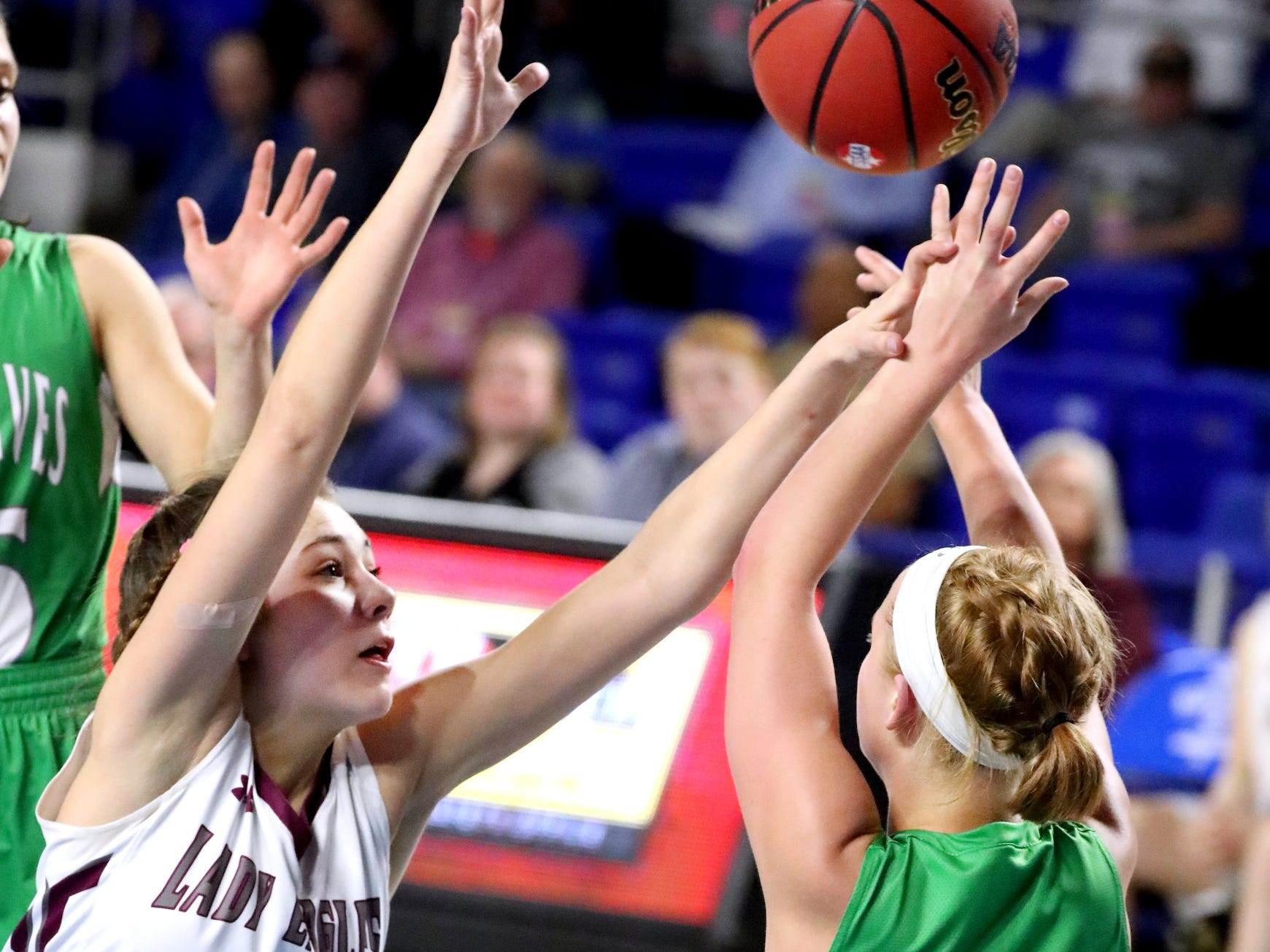 Eagleville's Elizabeth Thompson (5) tries to block a pass mode by Midway's Paige Bacon (5) after Bacon recovers a ball from the floor during the quarterfinal round of the TSSAA Div. 1 Class A Girls State Tournament, on Thursday, March 7, 2019, at Murphy Center in Murfreesboro, Tenn.