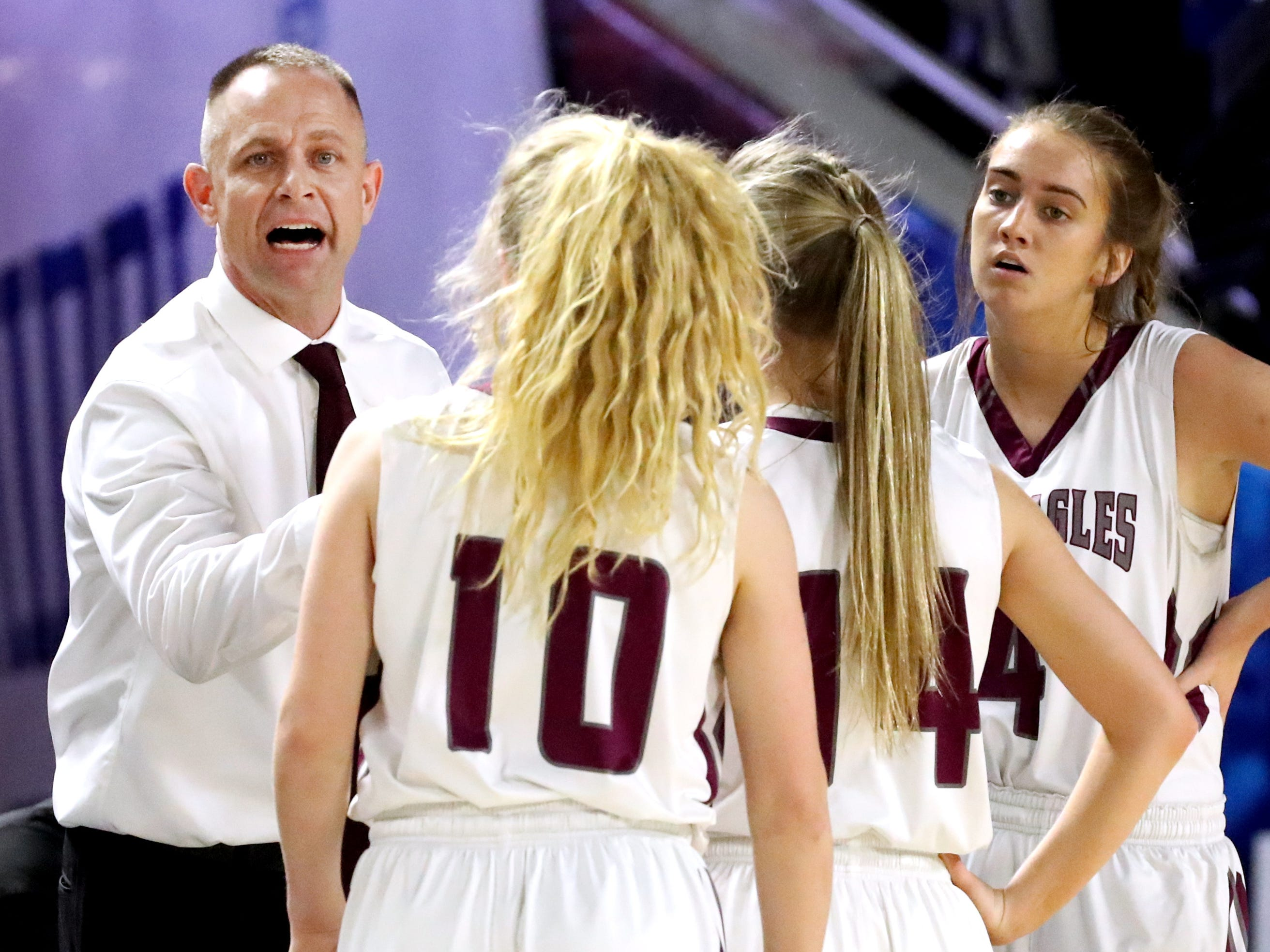 Eagleville's head coach Chris Lynch talks with his players during a free throw during the quarterfinal round of the TSSAA Div. 1 Class A Girls State Tournament Midway, on Thursday, March 7, 2019, at Murphy Center in Murfreesboro, Tenn.