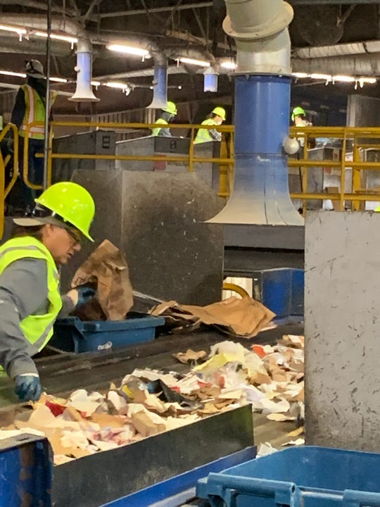 A worker sorts items that can be recycled at an operation in the San Jose, Calif., area. Officials from Rutherford County visited the recycling center to examine what can be replicated.