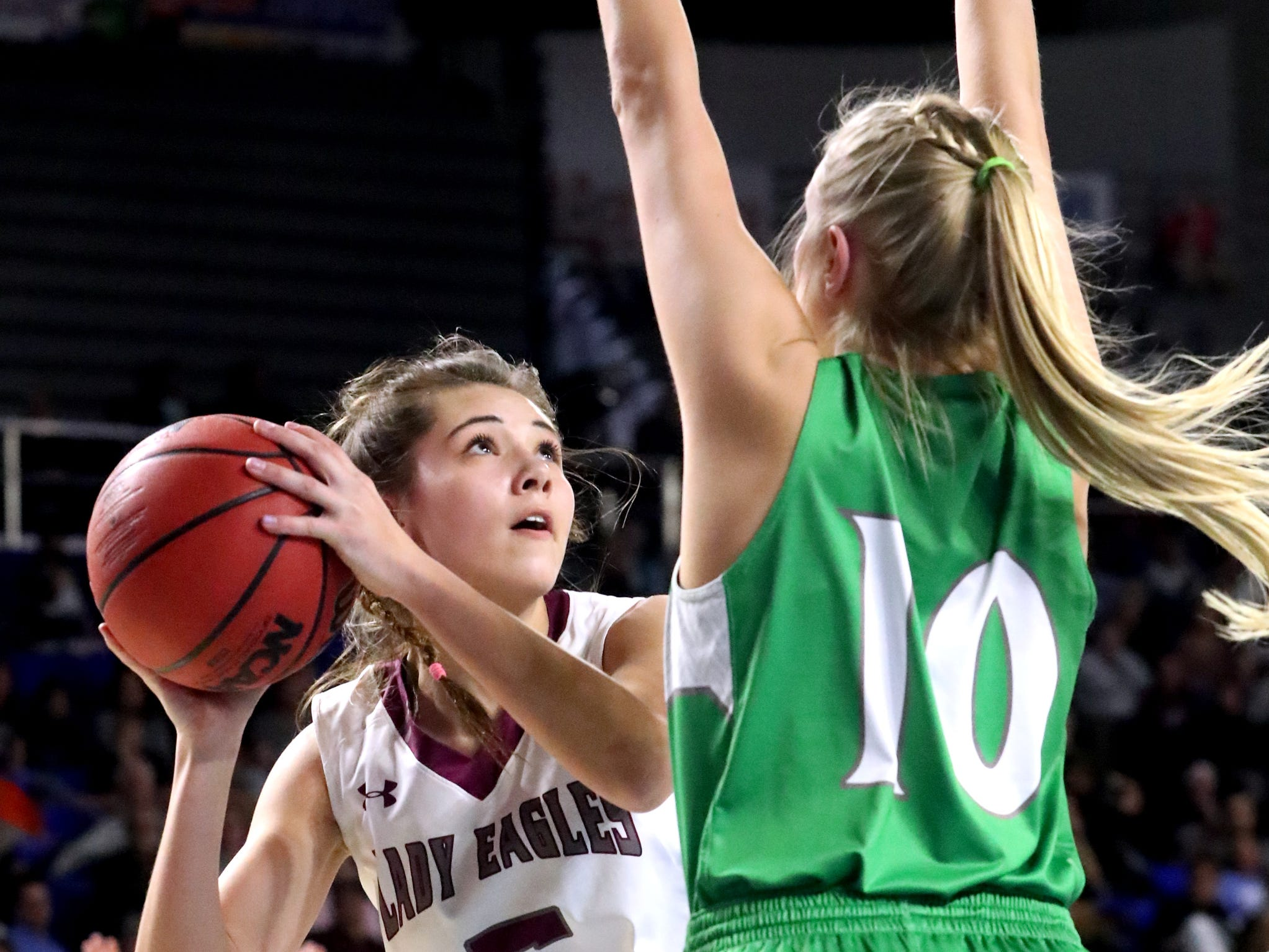 Eagleville's Elizabeth Thompson (5) shoots the bal a Midway's Heaven Prinzi (10) guards her during the quarterfinal round of the TSSAA Div. 1 Class A Girls State Tournament, on Thursday, March 7, 2019, at Murphy Center in Murfreesboro, Tenn.