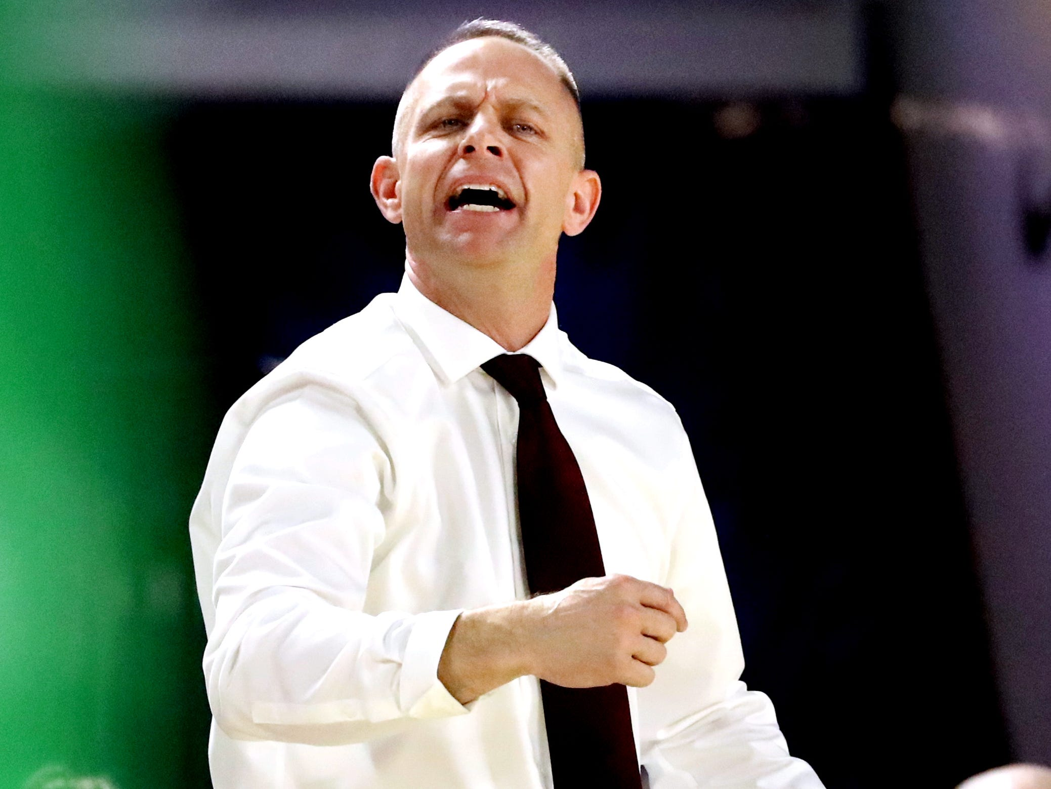 Eagleville's head coach Chris Lynch on the sidelines during the quarterfinal round of the TSSAA Div. 1 Class A Girls State Tournament against Midway, on Thursday, March 7, 2019, at Murphy Center in Murfreesboro, Tenn.