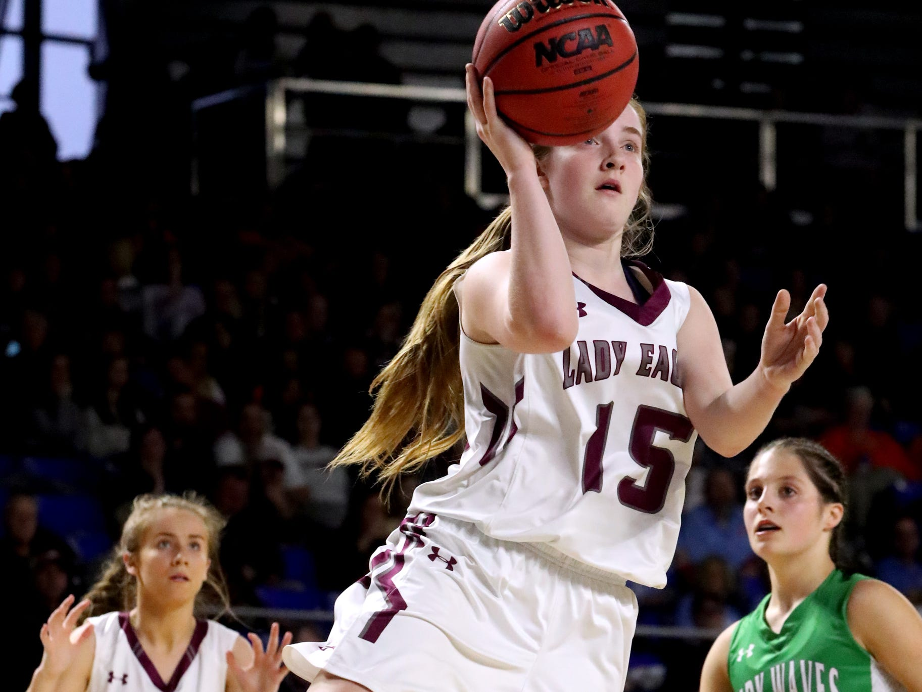 Eagleville's Makayla Moates (15) shoots the ball as teammate Eagleville's Haylee Ferguson (00) reacts in th background during the quarterfinal round of the TSSAA Div. 1 Class A Girls State Tournament Midway, on Thursday, March 7, 2019, at Murphy Center in Murfreesboro, Tenn.
