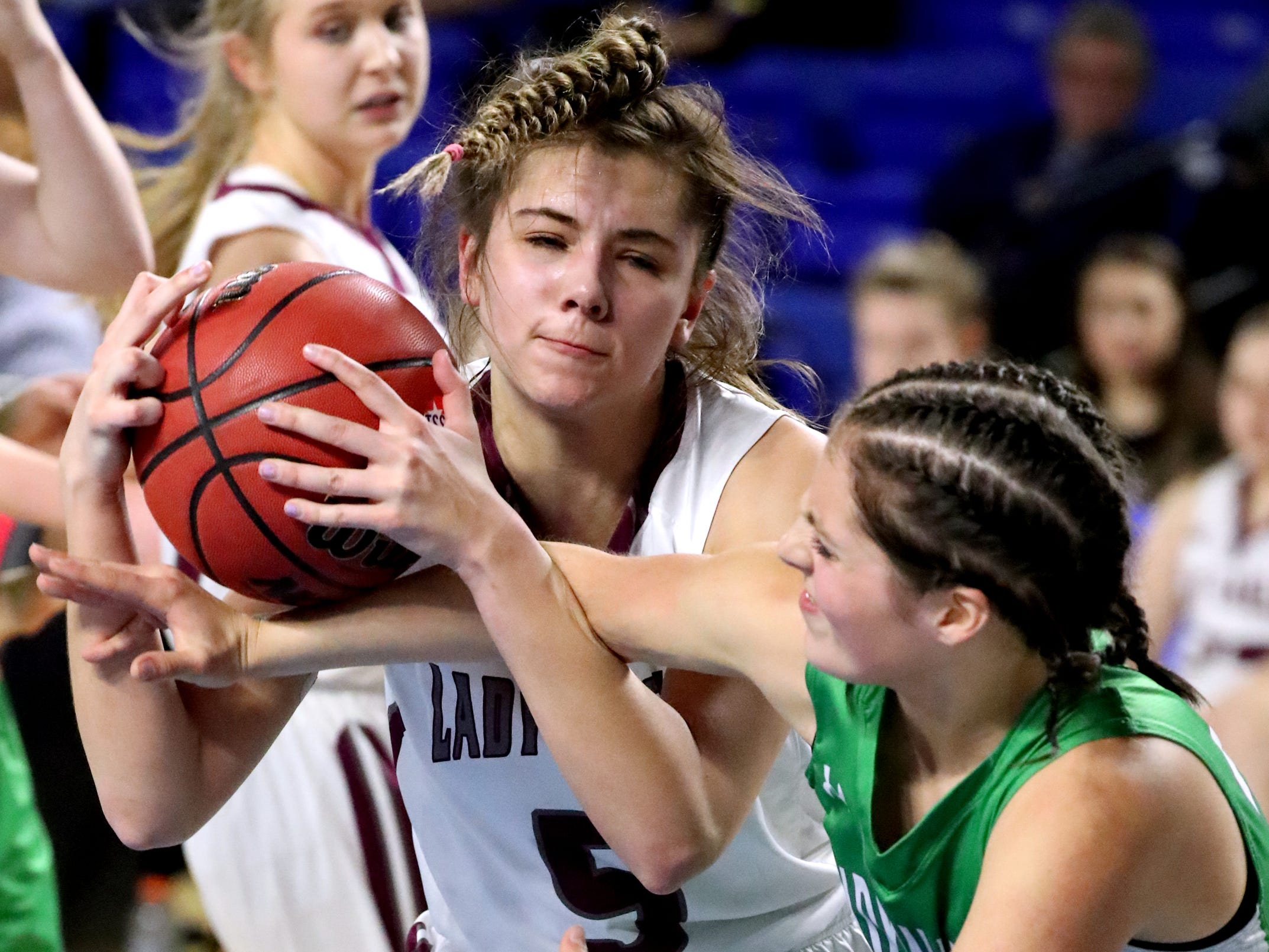 Eagleville's Elizabeth Thompson (5) and Midway's Emmy Taylor (25) both fight for position for the ball during the quarterfinal round of the TSSAA Div. 1 Class A Girls State Tournament, on Thursday, March 7, 2019, at Murphy Center in Murfreesboro, Tenn.