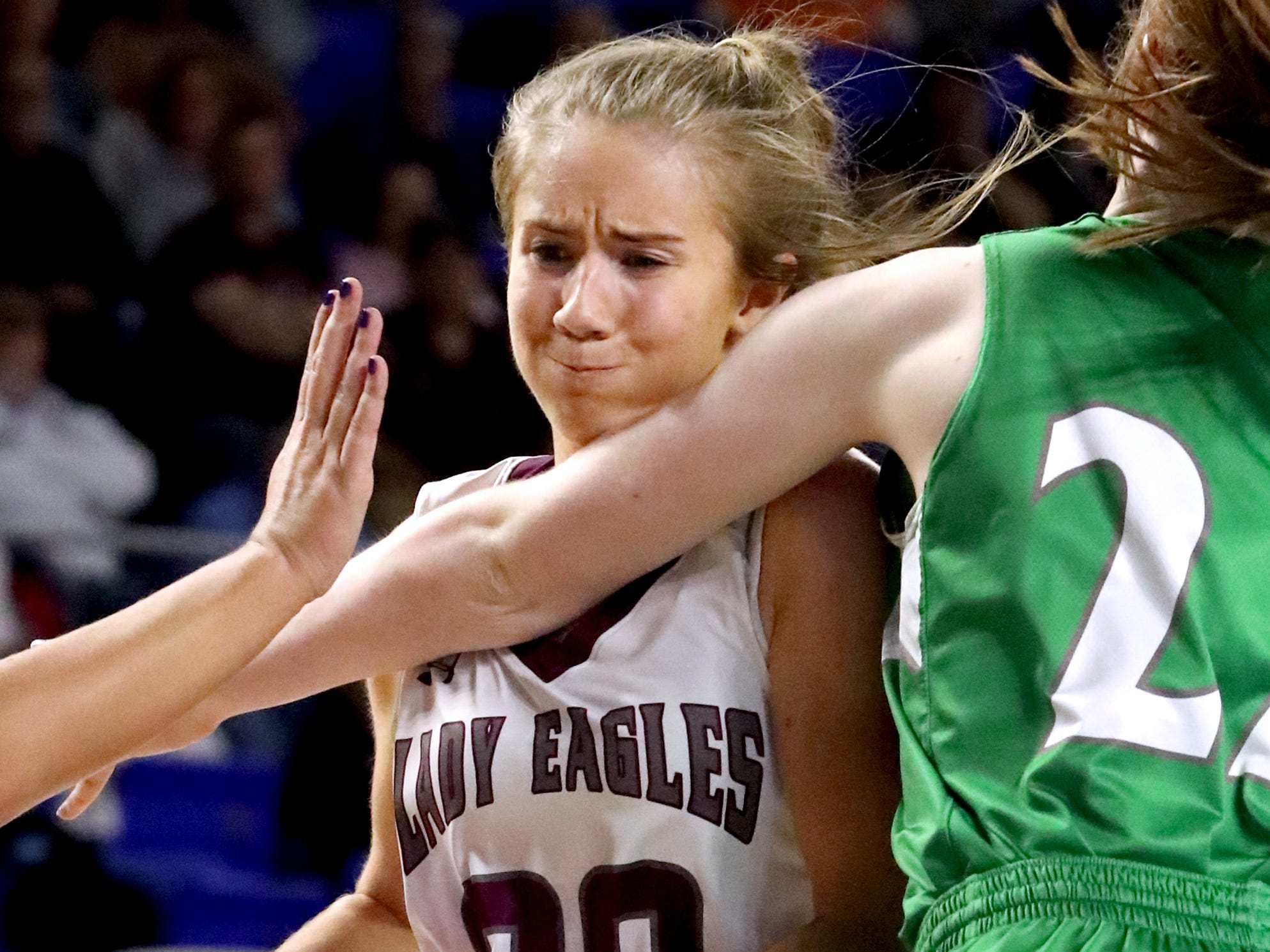 Eagleville's Haylee Ferguson (00) pushes toward the basket as Midway's Emily Cawood (22) guards her during the quarterfinal round of the TSSAA Div. 1 Class A Girls State Tournament, on Thursday, March 7, 2019, at Murphy Center in Murfreesboro, Tenn.