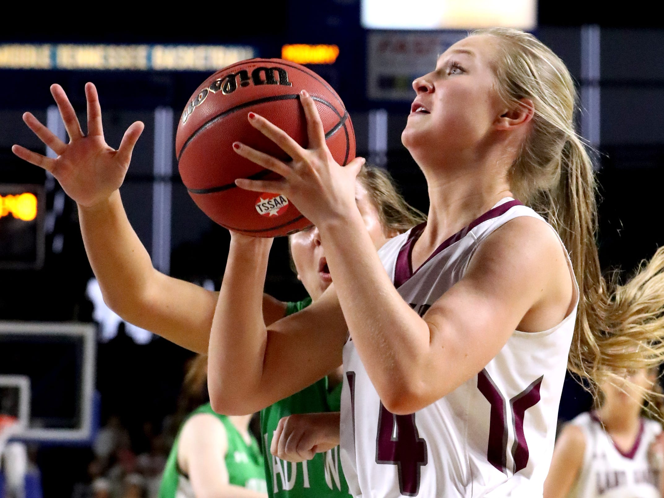 Eagleville's Mary Elise Lynch (14) shoots the ball as Midway's Rebecca Lemasters (3) guards her during the quarterfinal round of the TSSAA Div. 1 Class A Girls State Tournament, on Thursday, March 7, 2019, at Murphy Center in Murfreesboro, Tenn.