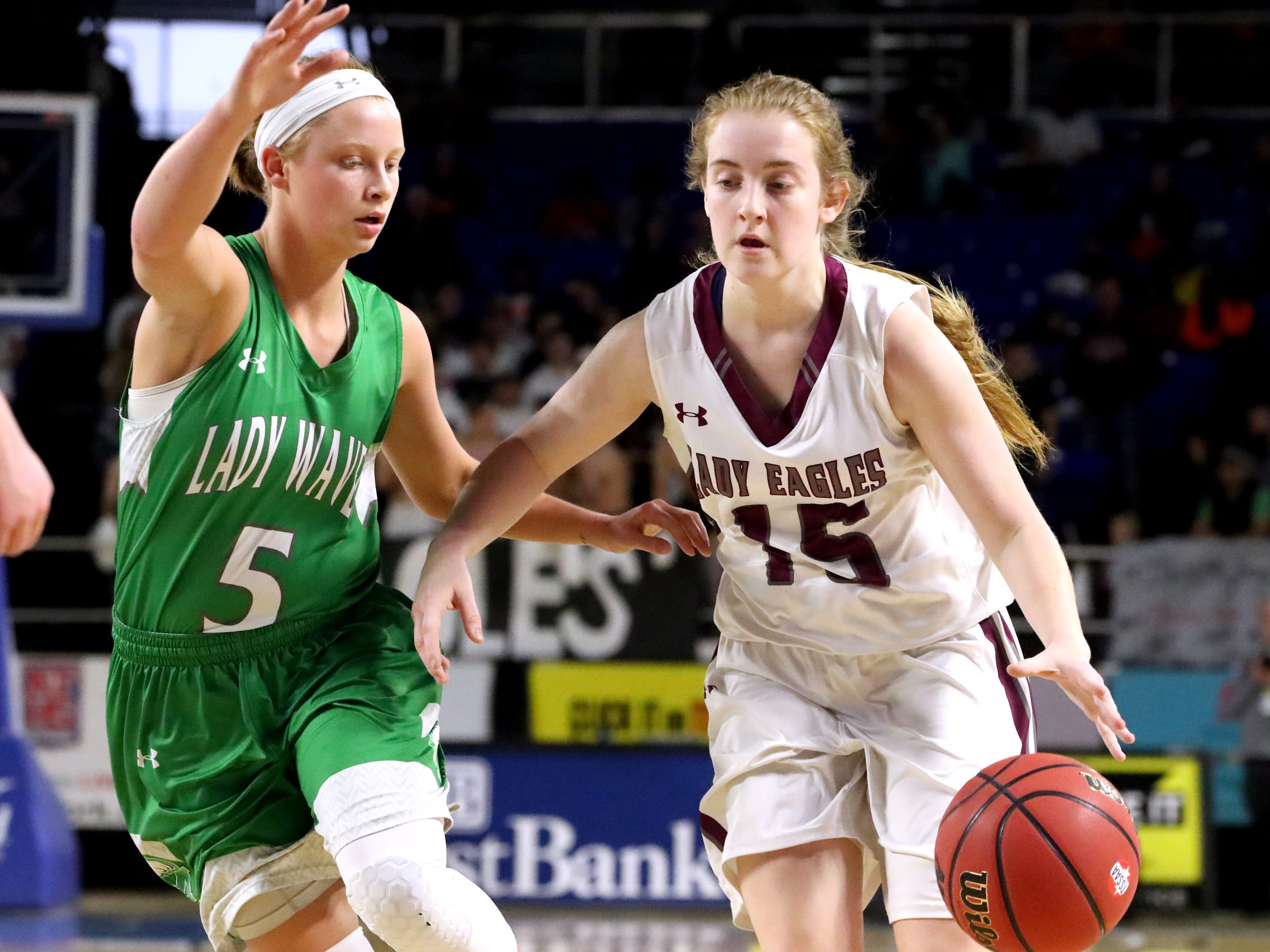 Eagleville's Makayla Moates (15) bring the ball up the court s Midway's Paige Bacon (5) guards her during the quarterfinal round of the TSSAA Div. 1 Class A Girls State Tournament, on Thursday, March 7, 2019, at Murphy Center in Murfreesboro, Tenn.