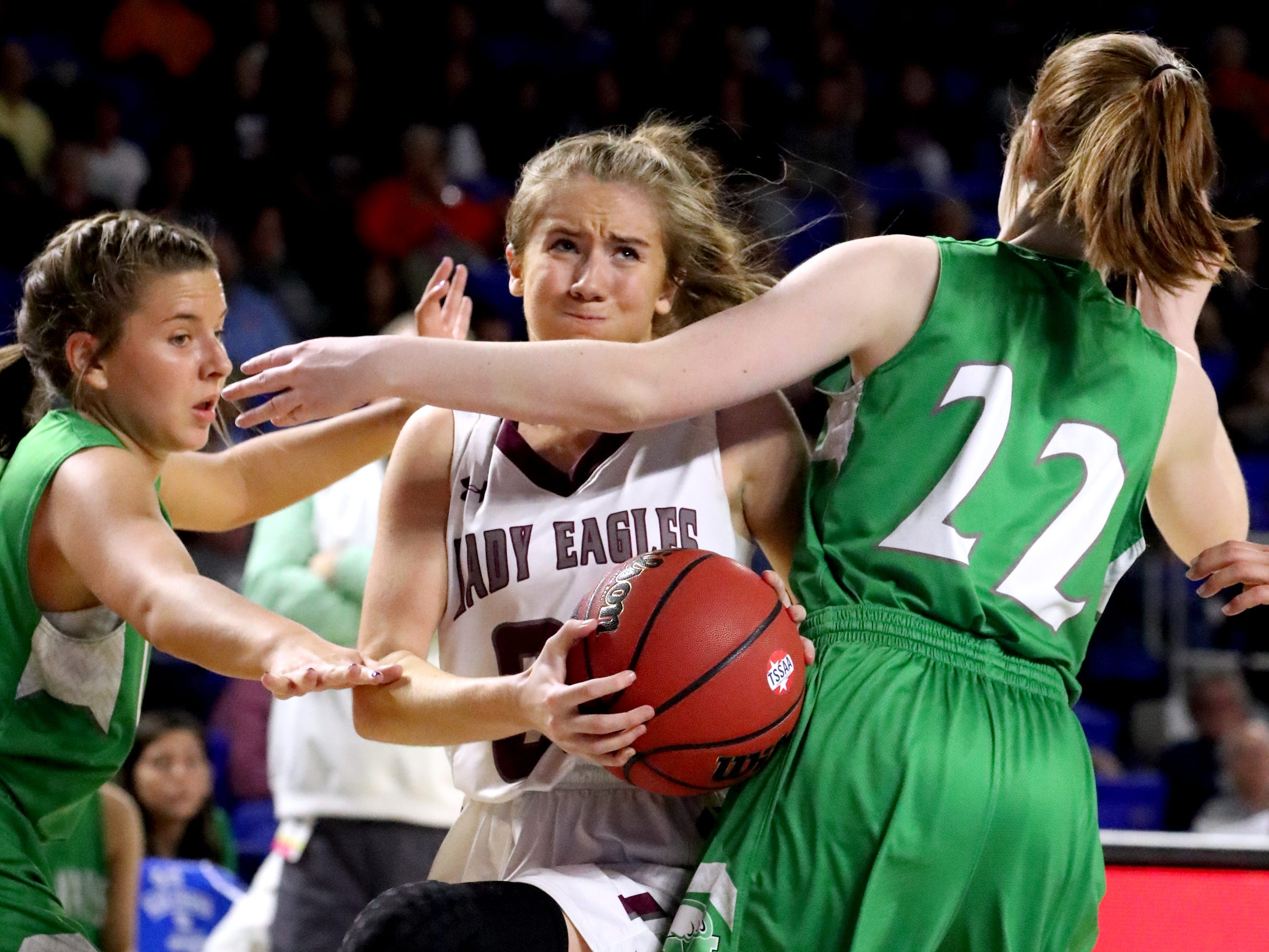 Eagleville's Haylee Ferguson (00) goes up for a shot between Midway's Rebecca Lemasters (3) and Emily Cawood (22) during the quarterfinal round of the TSSAA Div. 1 Class A Girls State Tournament, on Thursday, March 7, 2019, at Murphy Center in Murfreesboro, Tenn.