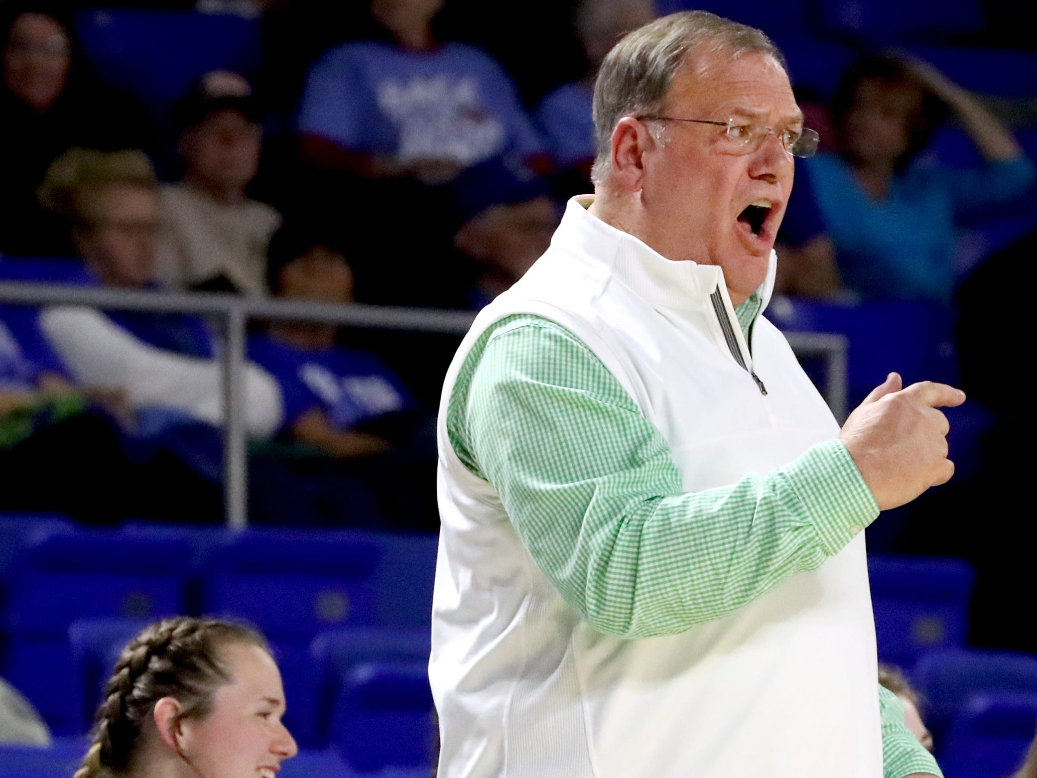 Midway's head coach Michael Hayes on the sidelines during the quarterfinal round of the TSSAA Div. 1 Class A Girls State Tournament against Eagleville, on Thursday, March 7, 2019, at Murphy Center in Murfreesboro, Tenn.