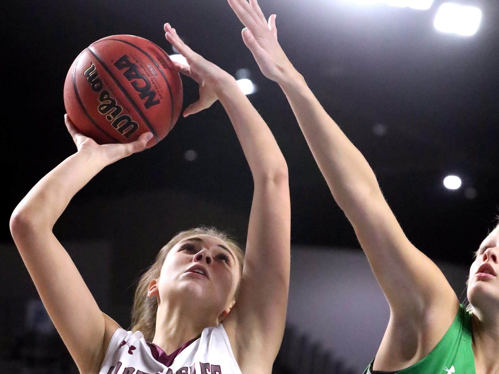 Eagleville's Elizabeth Thompson (5) goes up for a shot  as Midway's Heaven Prinzi (10) guards her during the quarterfinal round of the TSSAA Div. 1 Class A Girls State Tournament, on Thursday, March 7, 2019, at Murphy Center in Murfreesboro, Tenn.