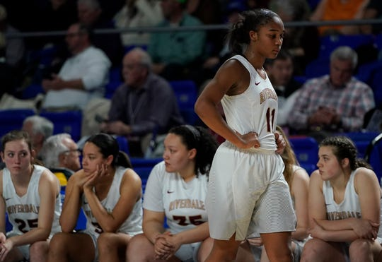 A dejected Aislynn Hayes walks near the Riverdale bench following the Lady Warriors' 78-72, double-overtime loss to Houston in the Class AAA state semifinals Friday at MTSU's Murphy Center.