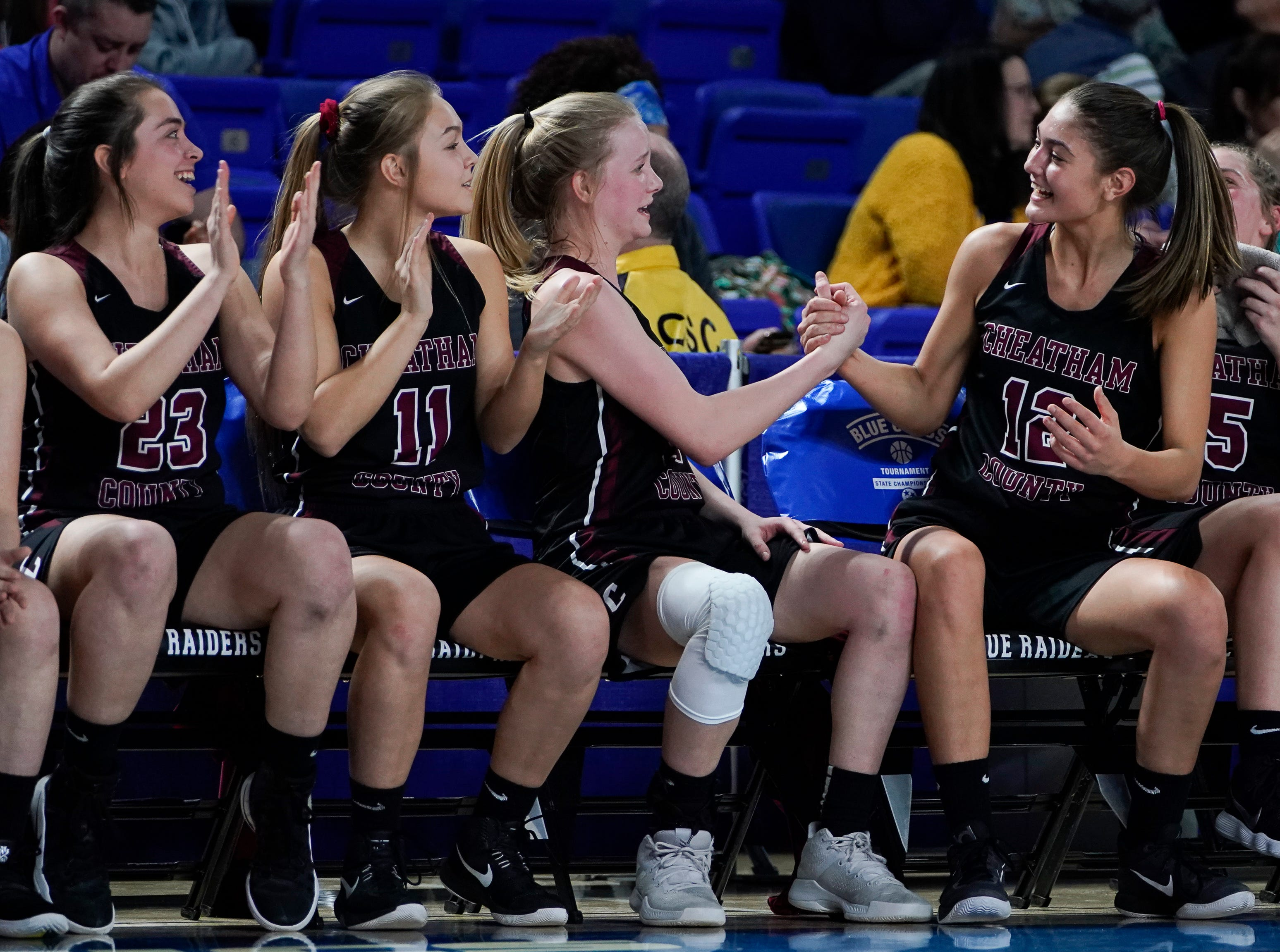 Cheatham Co. celebrates their 75 to 51 win over Macon Co. at the end of their semifinal game in the Division I Class AA Girls TSSAA Girls State Championships at Murphy Center Friday, March 8, 2019 in Murfreesboro, Tenn.