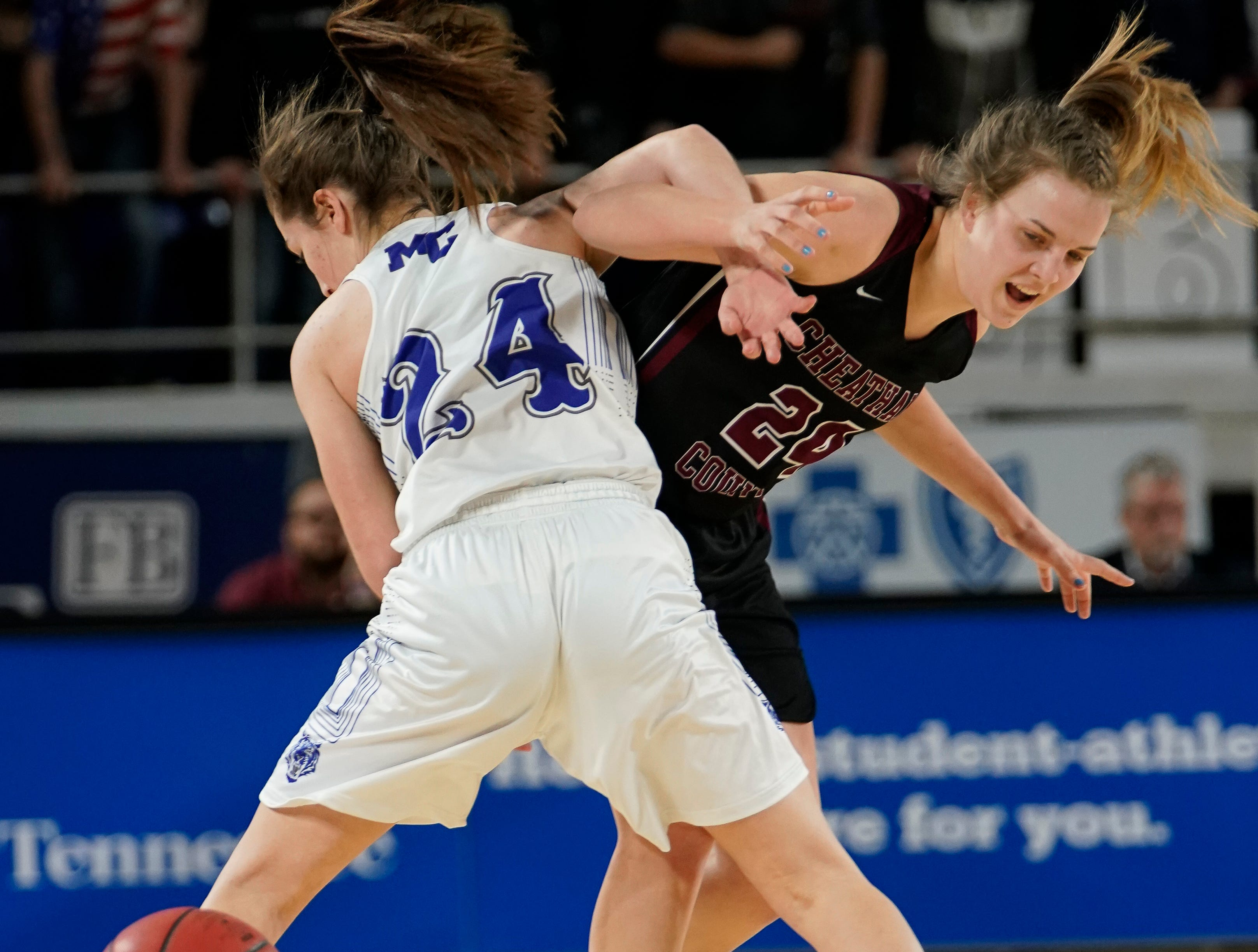 Macon Co. guard Keeley Carter (24) and Cheatham Co. center Alli Douglas (24) battle for loose ball during the first half of their semifinal game in the Division I Class AA Girls TSSAA Girls State Championships at Murphy Center Friday, March 8, 2019 in Murfreesboro, Tenn.