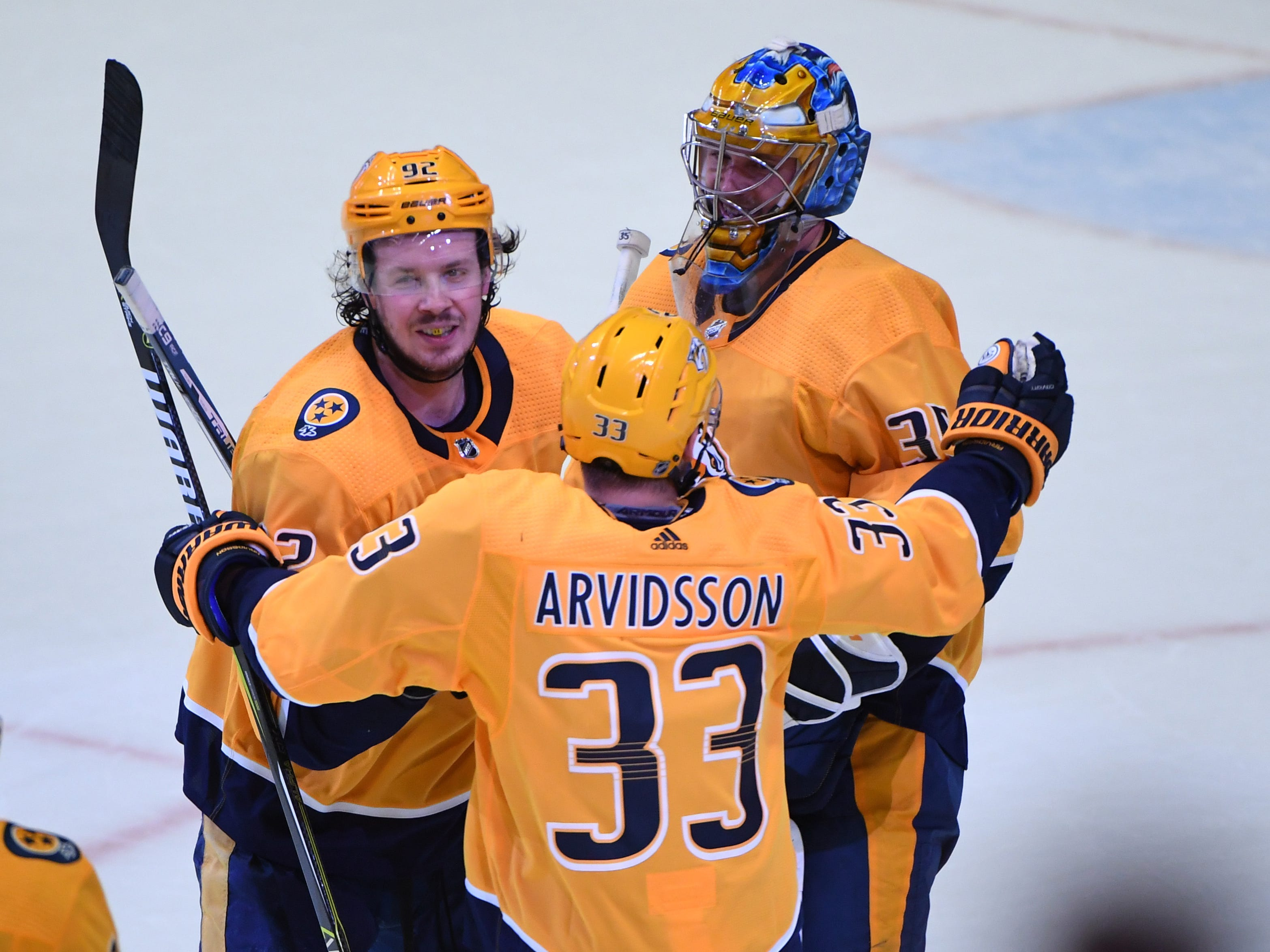 Mar 5, 2019;: Predators 5, Wild 4 (SO) -- Nashville Predators center Ryan Johansen (92) Nashville Predators right wing Viktor Arvidsson (33) and Nashville Predators goaltender Pekka Rinne (35) celebrate after a shootout win against the Minnesota Wild at Bridgestone Arena.
