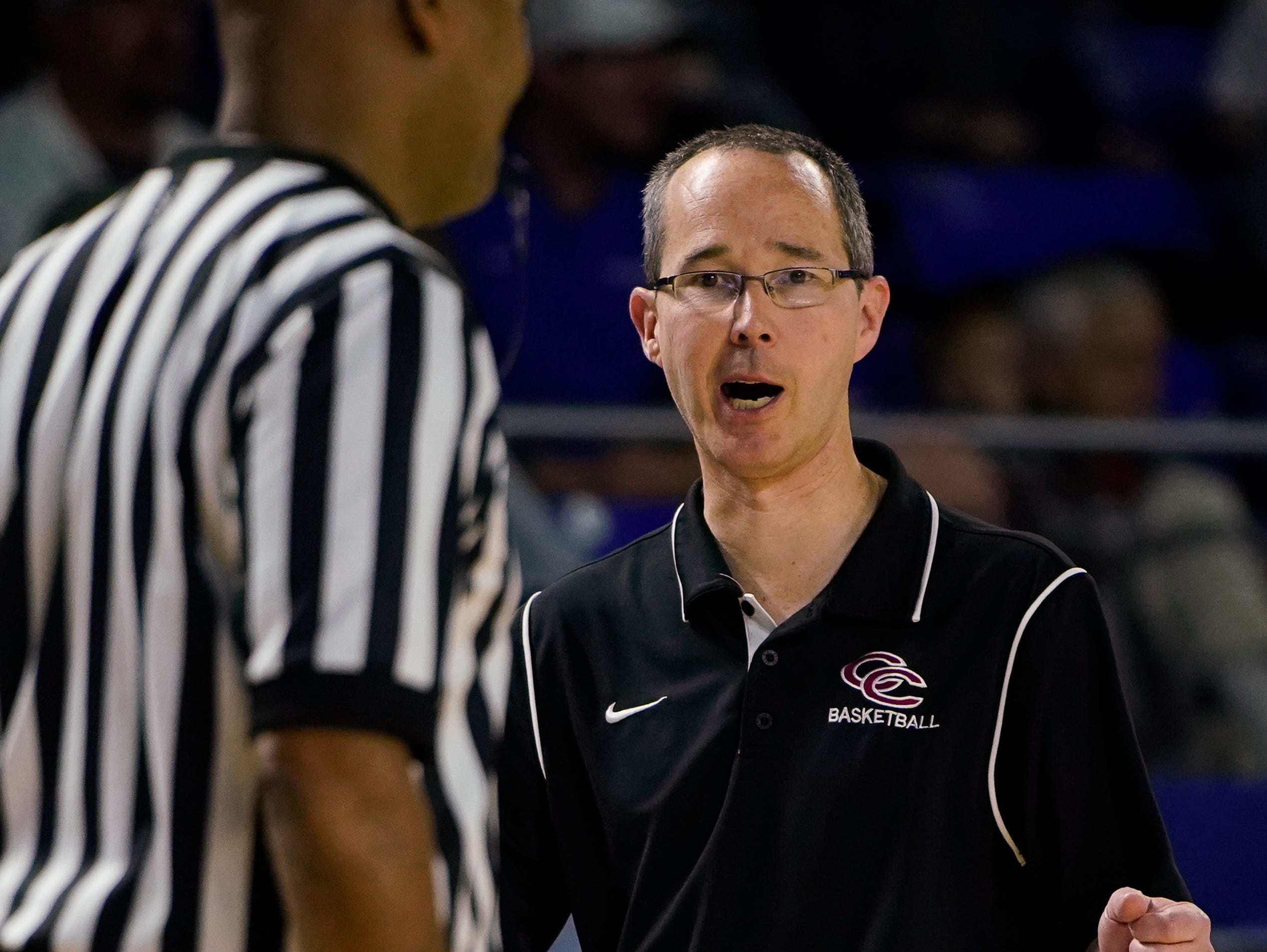 Cheatham Co. head coach Jim Gibbs a referee during a timeout during the second half of their semifinal game against Macon Co. in the Division I Class AA Girls TSSAA Girls State Championships at Murphy Center Friday, March 8, 2019 in Murfreesboro, Tenn.