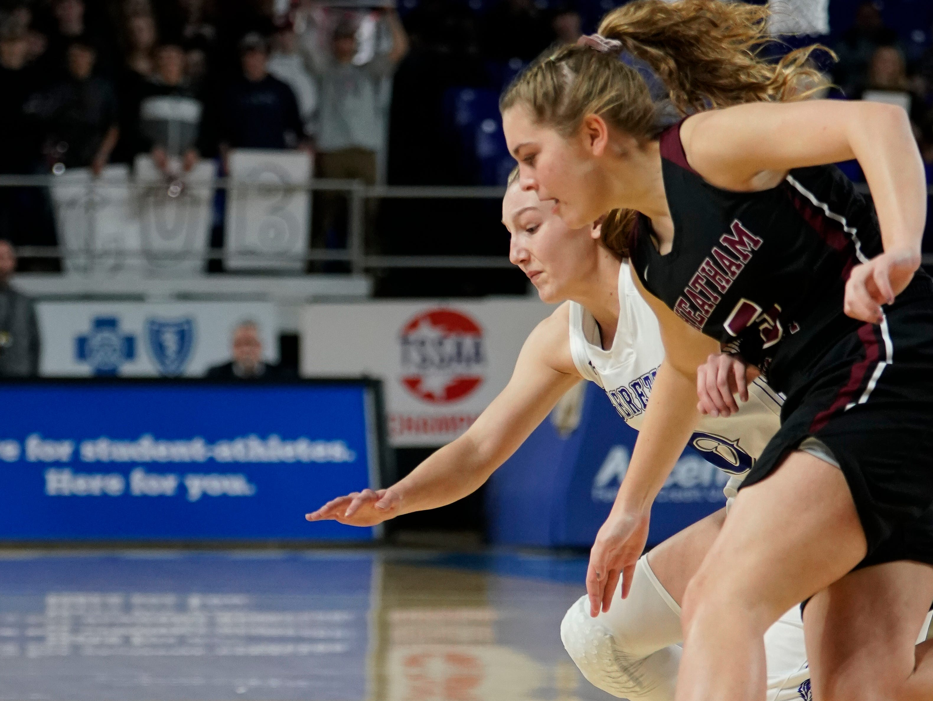 Macon Co. guard Jalynn Gregory (10) and Cheatham Co. guard Eryn Nelson (5) dive for a loose ball during the first half of their semifinal game in the Division I Class AA Girls TSSAA Girls State Championships at Murphy Center Friday, March 8, 2019 in Murfreesboro, Tenn.