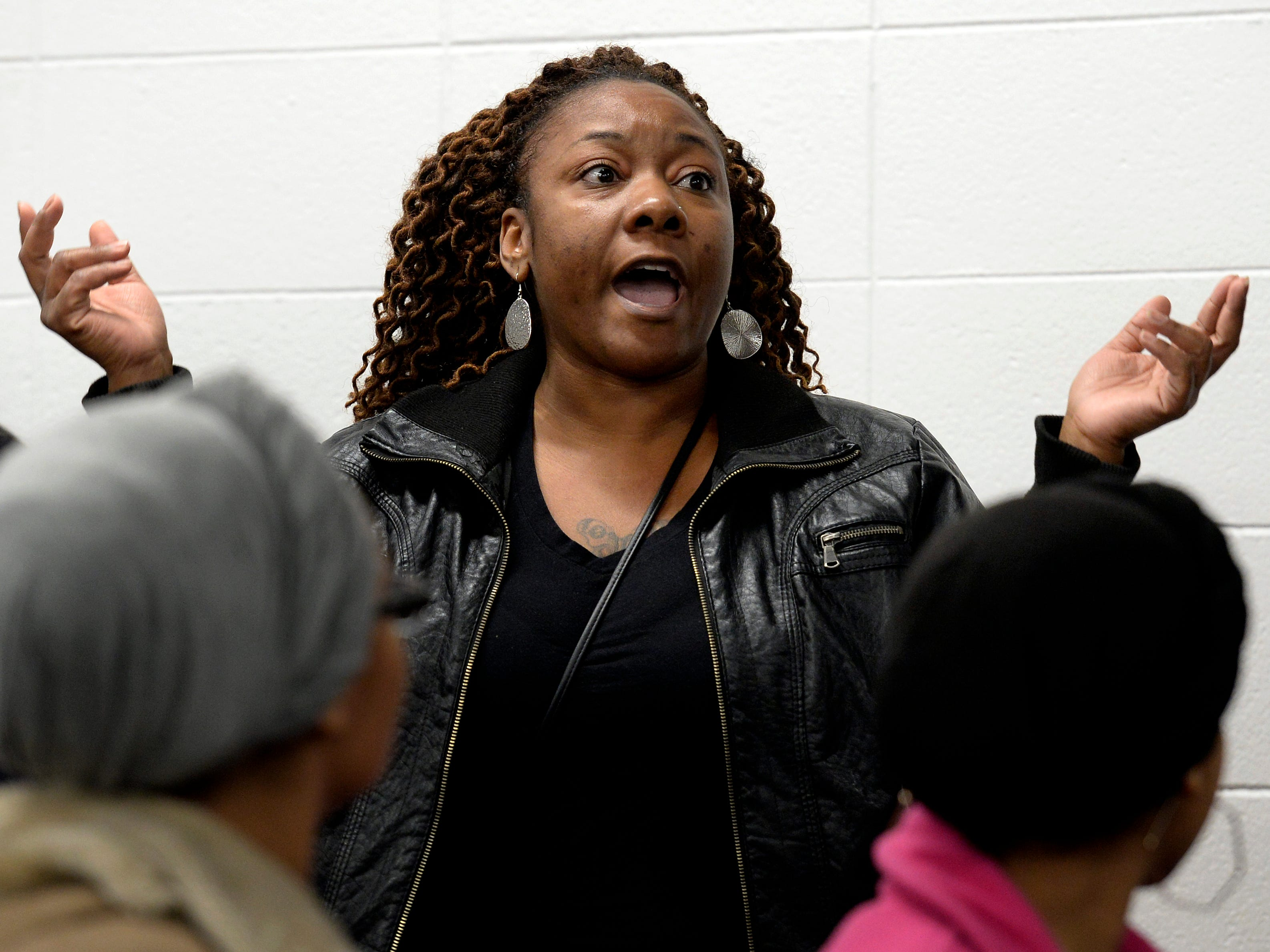 Concerned parent Marek Winters voices her anger and frustration during a parent meeting about New Vision Academy charter school on Thursday, March 7, 2019 in Nashville, Tenn.