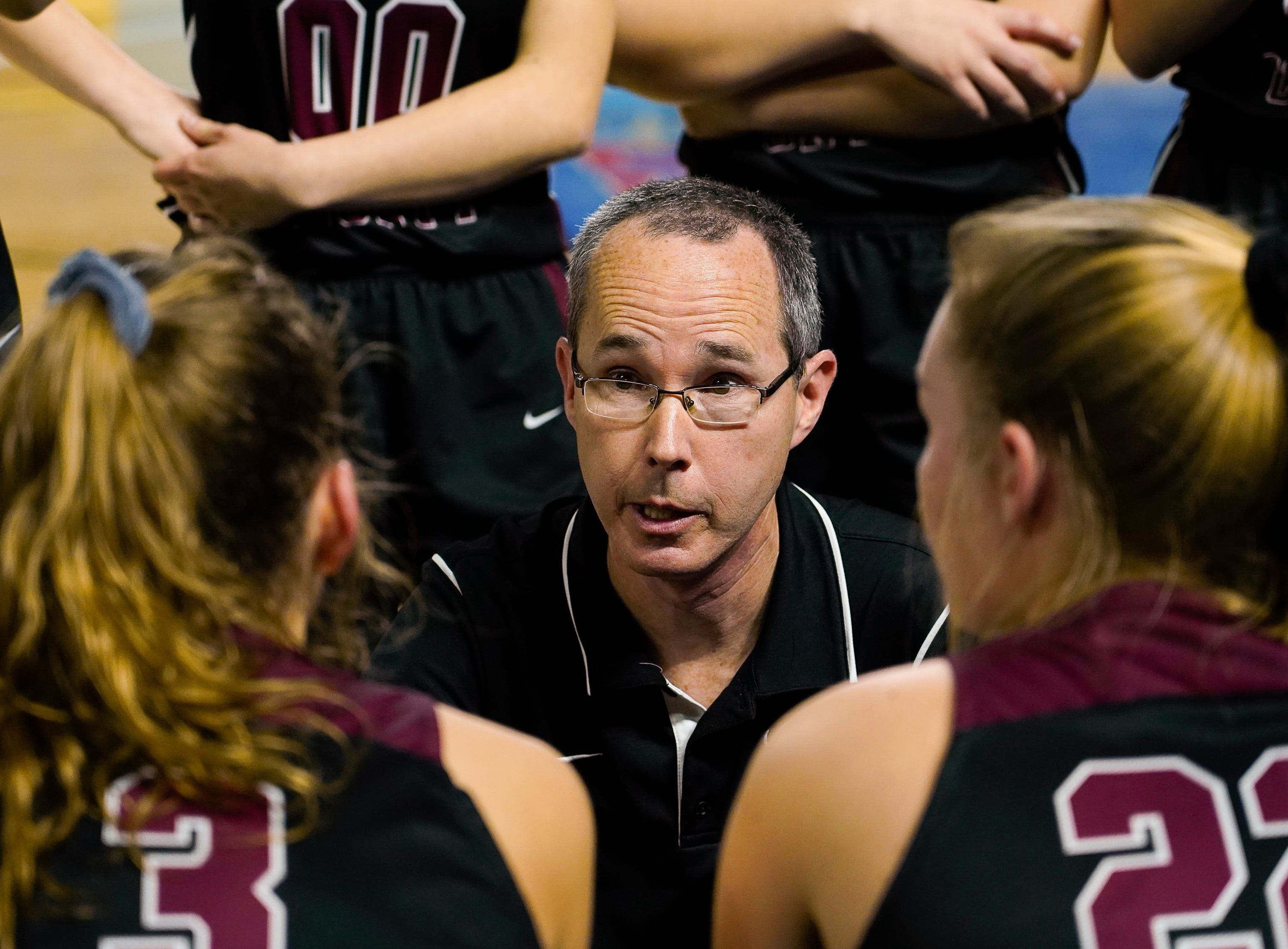 Cheatham Co. head coach Jim Gibbs talks with his team during a timeout during the second half of their semifinal game against Macon Co. in the Division I Class AA Girls TSSAA Girls State Championships at Murphy Center Friday, March 8, 2019 in Murfreesboro, Tenn.