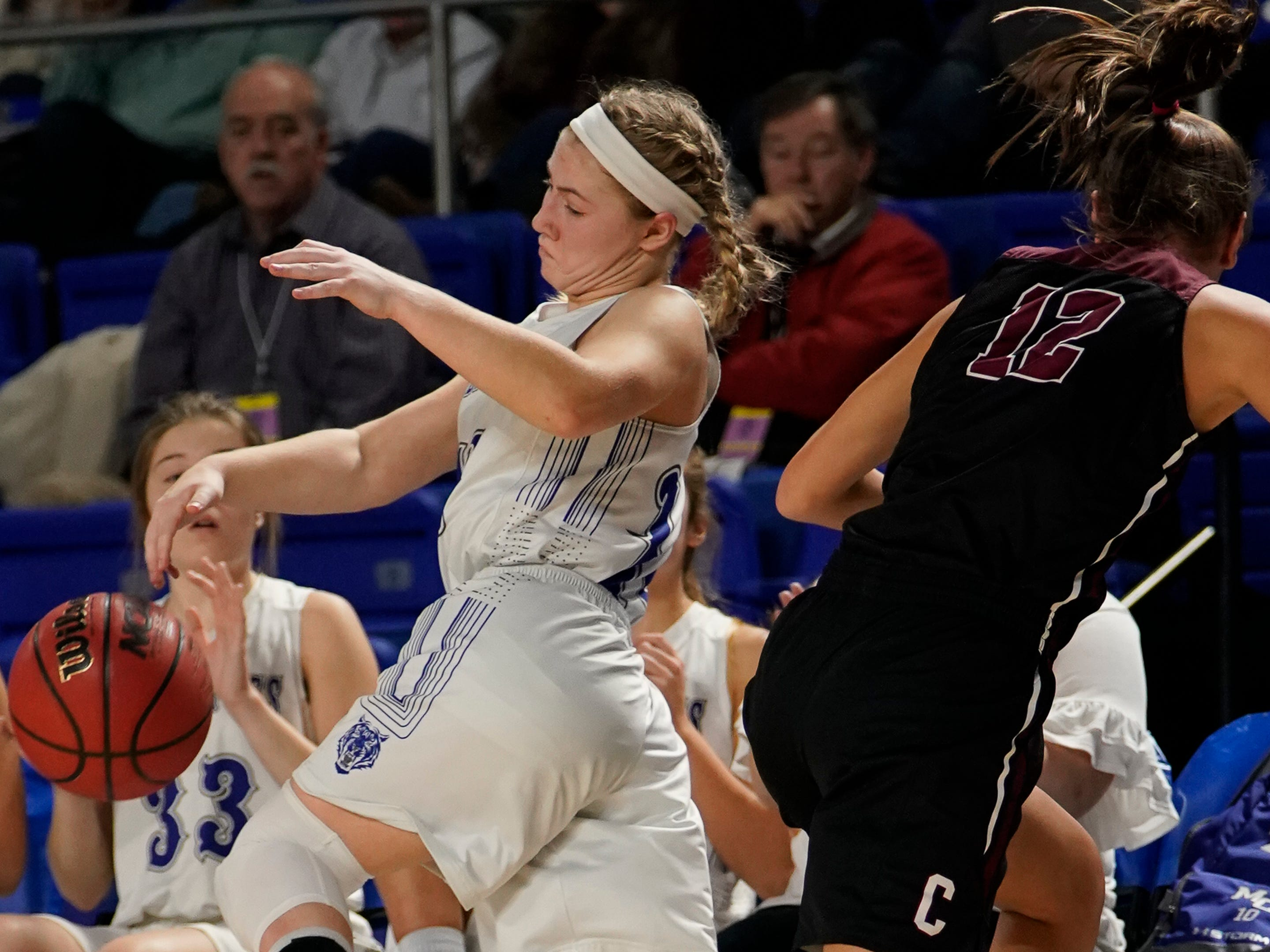 Macon Co. guard Abby Shoulders (14) tries to save the ball from going out of bounds past Cheatham Co. forward Jorden Bumpus (12) during the first half of their semifinal game in the Division I Class AA Girls TSSAA Girls State Championships at Murphy Center Friday, March 8, 2019 in Murfreesboro, Tenn.