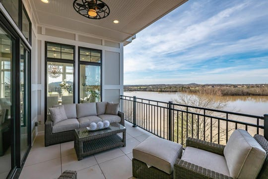 Revery Point offers exclusive, lakefront condos with multiple lake views, such as this covered porch.