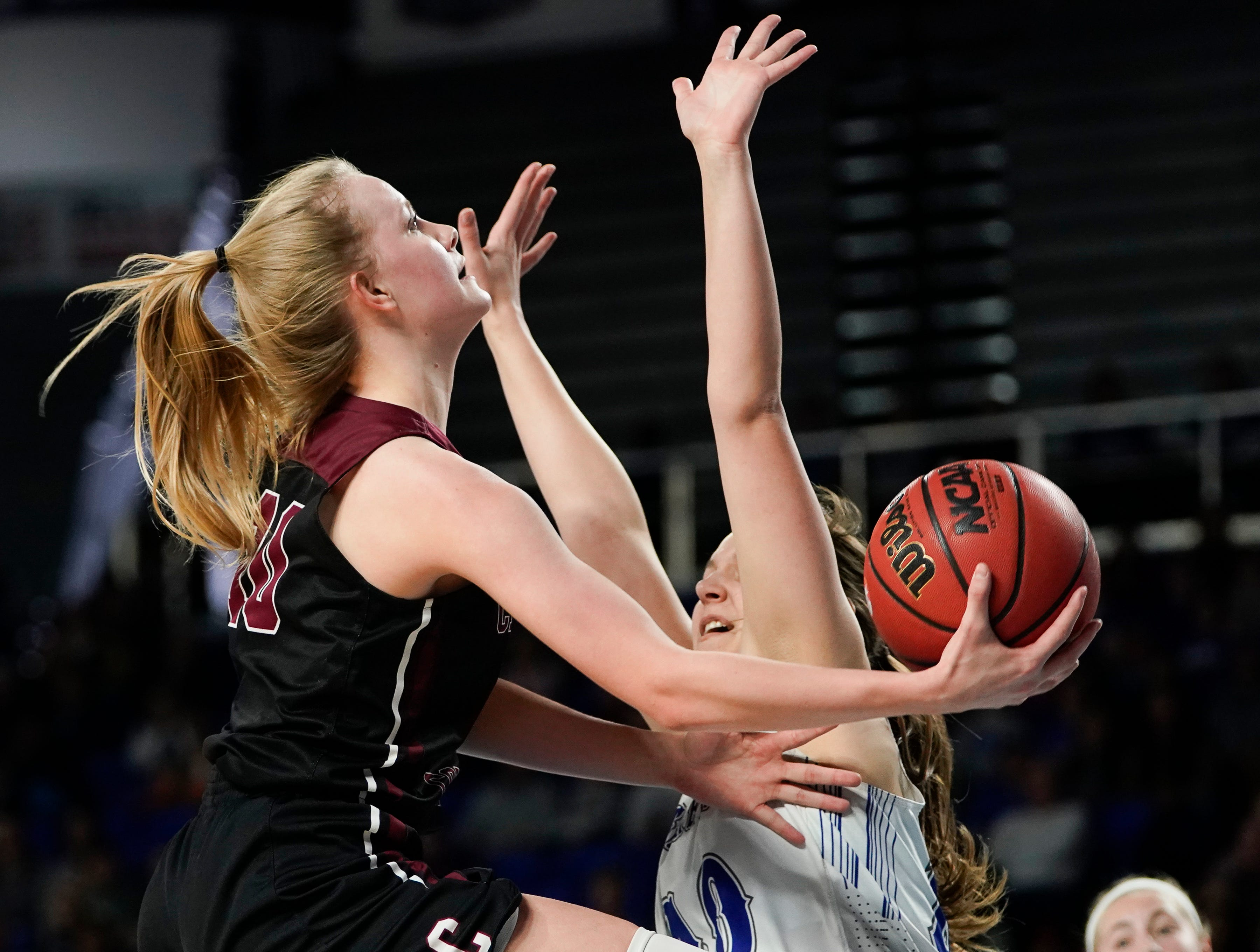 Cheatham Co. guard Abbi Douglas (10) shoots past Macon Co. guard Jalynn Gregory (10) during the first half of their semifinal game in the Division I Class AA Girls TSSAA Girls State Championships at Murphy Center Friday, March 8, 2019 in Murfreesboro, Tenn.