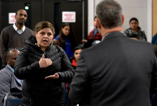Parent Shirley Maldonado expresses her anger and concern to MNPS Executive Director of Charter Schools Dennis Queen  during a parent meeting on Thursday, March 7, 2019 in Nashville, Tenn. Parents are scrambling to find other schools for their children to attend.