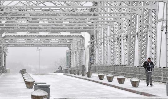 Snow starts to fall on Jan. 12, 2018 on the  John Seigenthaler Pedestrian Bridge in Nashville.