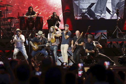 Zac Brown, Coy Bowles, Clay Cook, Daniel de los Reyes, Matt Mangano, Jimmy De Martini, Chris Fryar and John Driskell Hopkins with Zac Brown Band performs during the Down The Rabbit Hole Tour at SunTrust Park on Saturday, June 30, 2018, in Atlanta. (Photo by Robb Cohen/Invision/AP)