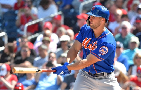 New York Mets designated hitter Tim Tebow bats against the Washington Nationals during a spring training game at FITTEAM Ballpark of the Palm Beaches.