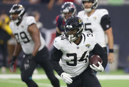 Dec 30, 2018; Houston, TX, USA; Jacksonville Jaguars running back Carlos Hyde (34) rushes against the Houston Texans in the second half at NRG Stadium. Mandatory Credit: Thomas B. Shea-USA TODAY Sports