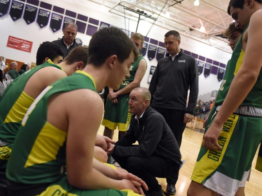 Eric Sheck talks to his Newark Catholic team during a game with Fisher Catholic last season. He will return to the Muskingum Valley League, as the Tri-Valley graduate was announced on Thursday as the new John Glenn head boys basketball coach.