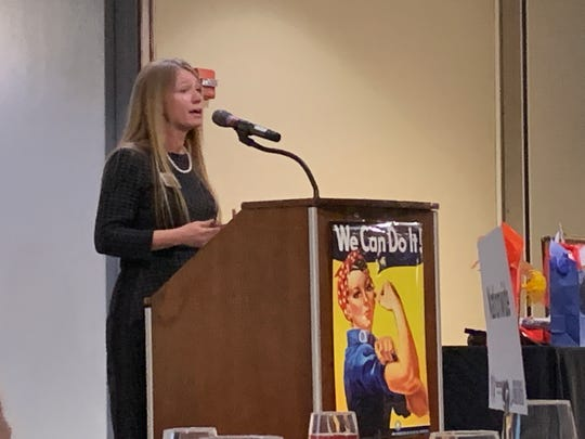 Deb Dingus, director of United Way of Licking County, introduces the guest speaker at Women United's inaugural celebration of International Women's Day on Thursday, March 7, 2019.