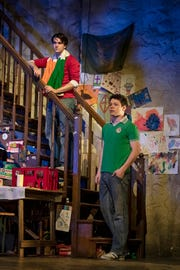 Collin Kelly-Sordelet (JJ Carney) stands on the stairs above Sean Delaney (Michael Carney)