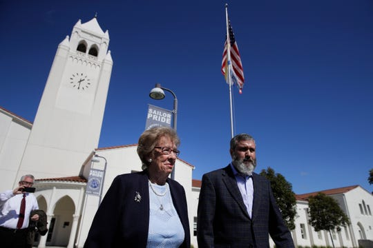 Eva Schloss, left, the stepsister of Anne Frank and a Holocaust survivor, and Rabbi Reuven Mintz leave Newport Harbor High School after a meeting with a group of students Thursday, March 7, 2019, in Newport Beach, Calif.