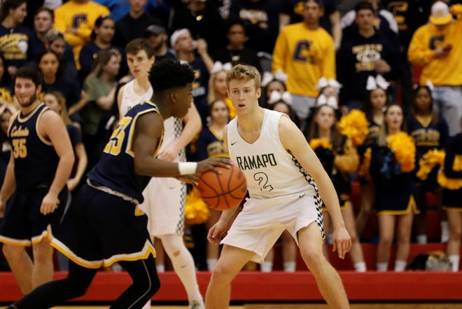 KC Hunt defends against Colonia's Jimmy Frage during Ramapo's Group 3 semifinal win vs. Colonia.