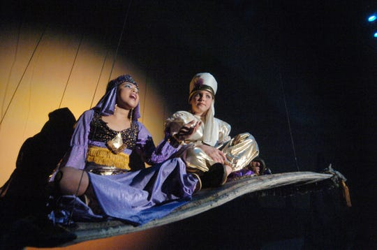 In one of his earlier stage productions, Collin Kelly-Sordelet (Aladdin) rides a magic carpet with Autumn Green (Jasmine) for a 2006 Hillside School performance.