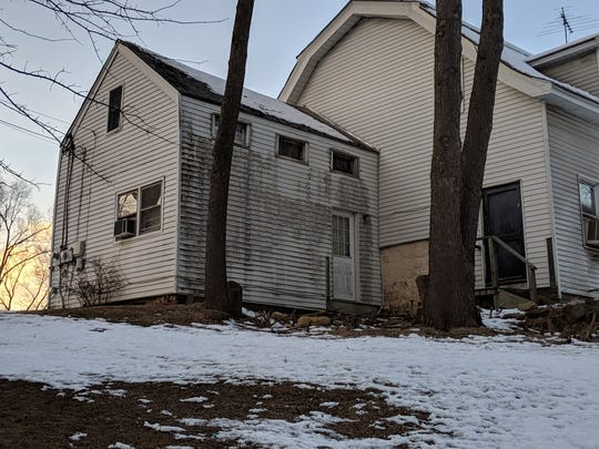 The aging exterior of Emerson's DeBaun House.