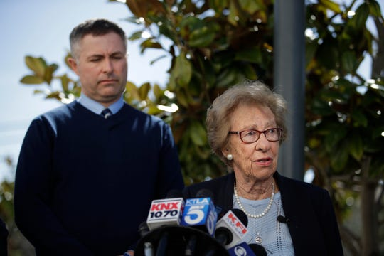 Joined by Newport Harbor High School Principal Sean Boulton, left, Eva Schloss, the stepsister of Anne Frank and a Holocaust survivor, talks to reporters during a news conference Thursday, March 7, 2019, in Newport Beach, Calif.