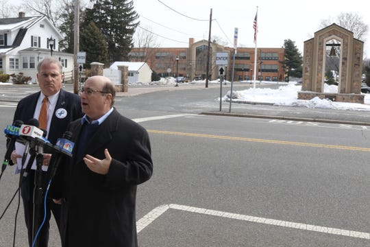Attorney, Gregory Gianforcaro representing an alleged victim of sexual abuse and Mark Crawford, with NJ SNAP, a group that advocates for the victims of childhood abuse, are across the street from the St. Bartholomew Roman Catholic Church in Scotch Plains announcing a lawsuit against the church and the Archdiocese of Newark on behalf of an anonymous victim of Father Kevin Gugliotta who was an associate paster at the church. The alleged victim says Gugliotta sexually abused him when Gugliotta was at St. Batholomews.