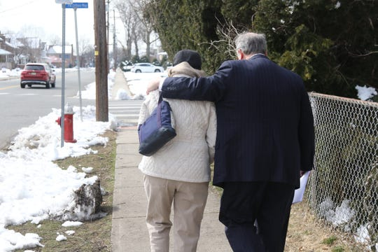 The mother of an anonymous victim of childhood sex abuse   leaves a press conference with her attorney Gregory Gianforcaro. They are across the street from the St. Bartholomew Roman Catholic Church in Scotch Plains where a lawsuit was announced against the church and the Archdiocese of Newark on behalf of an anonymous victim of Father Kevin Gugliotta who was an associate paster at the church. The alleged victim says Gugliotta sexually abused him when Gugliotta was at St. Batholomews. The mother wished to be anonymous.