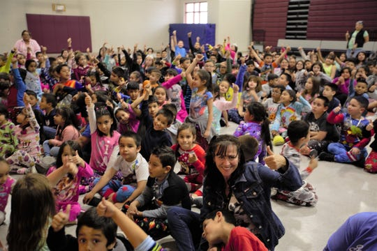 Students at Booker T. Washington Elementary School celebrate Friday, March 8, 2019, raising $1,500 for children in need — a total that combines the students' donations as well as a donation from Revolution 120.