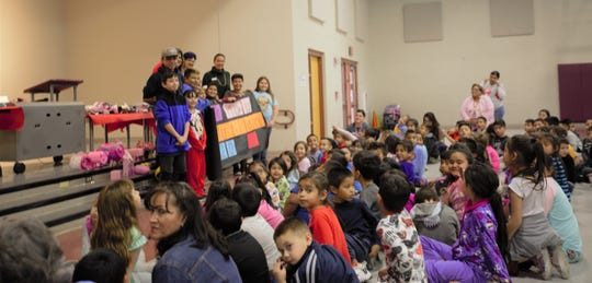 Students at Booker T. Washington Elementary School collected about $500 in spare change that will go to children in need as part of their third annual fundraiser Pennies for Piggies.