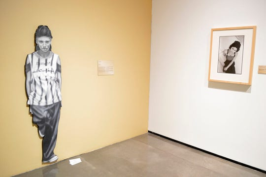 "In this Wednesday, March 6, 2019 photo, artwork hangs at the National Hispanic Cultural Center in Albuquerque, N.M. before the opening of a exhibit on the chola, a working-class, Mexican-American female often associated with urban gangs. The ""Que Chola Exhibition"" opened on Friday, March 8 with pieces by artists from New Mexico, Arizona, California, Texas, and Colorado."